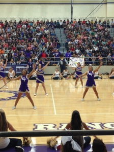 Firing up the crowd while the cheerleaders perform.